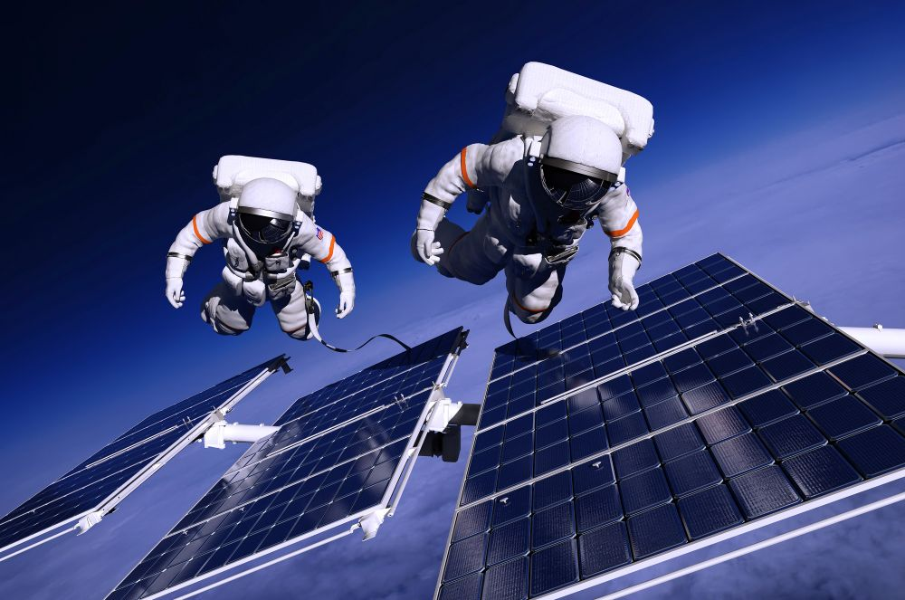Two astronauts in space floating around a set of panels