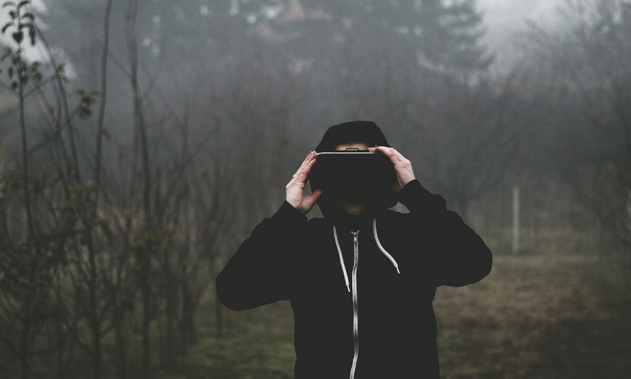 Virtual reality headset on a man outside in the forest