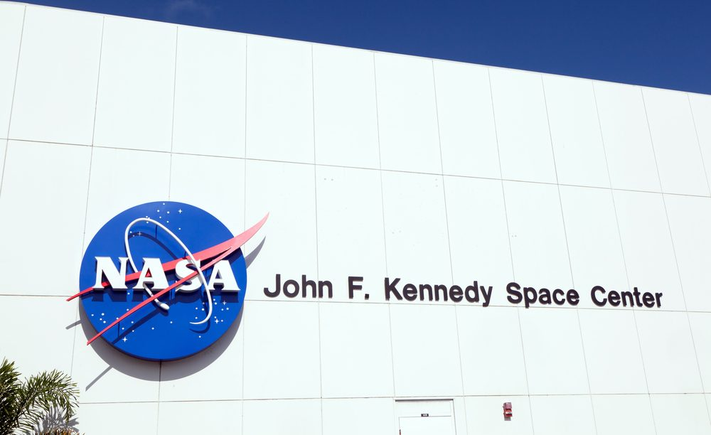 Facade of main entrance to the John F. Kennedy Space Center and NASA emblem displayed